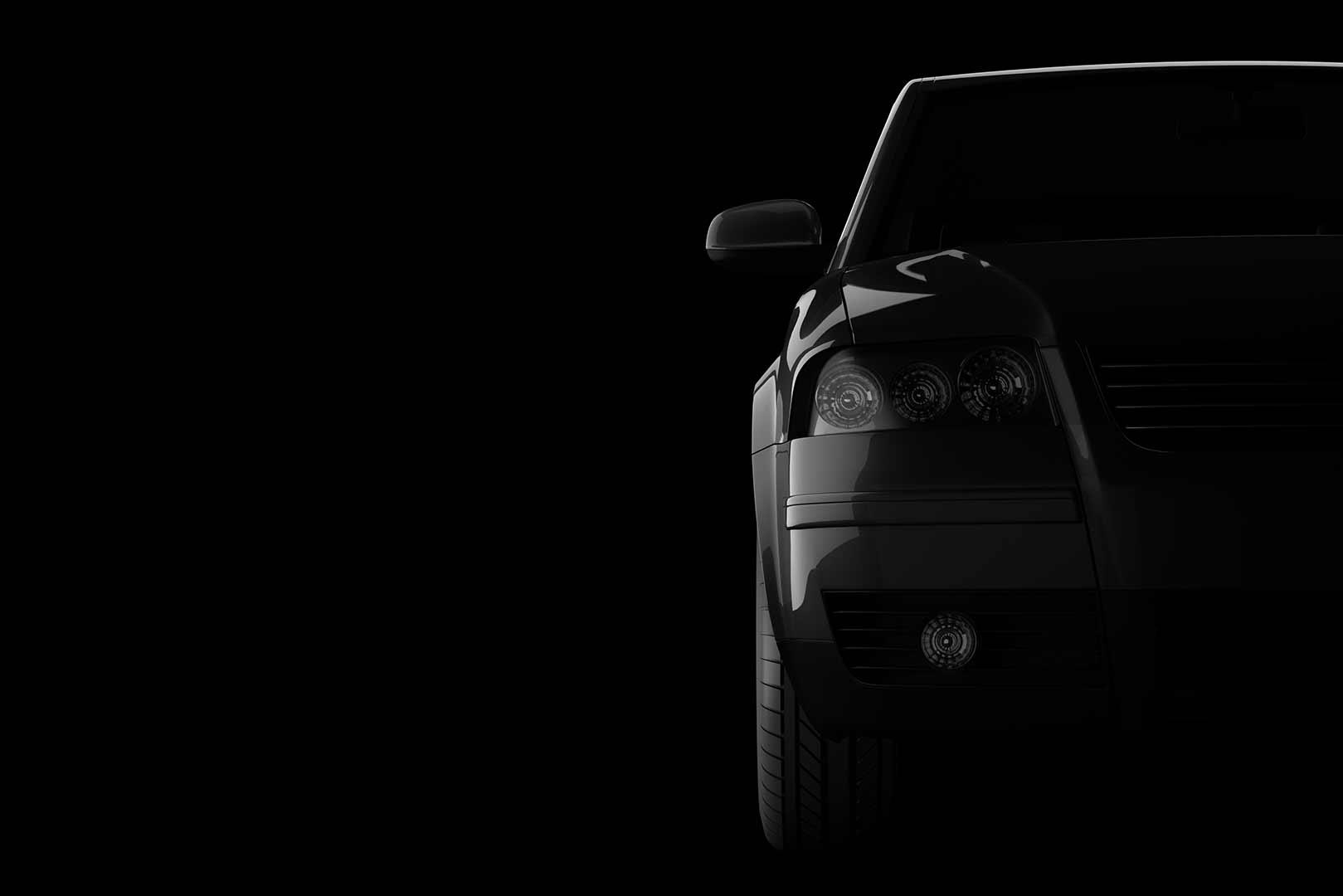 Schwarzes Auto auf schwarzem Hintergrund